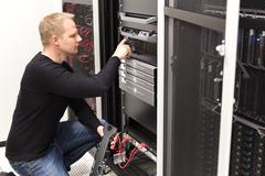 It technician maintain servers an SAN in datacenter Stock Photos