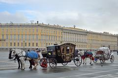 The horse-drawn carriage on Palace square St. Petersburg - stock photo