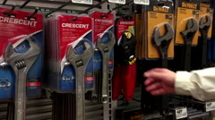 Woman buying Crescent adjustable wrench at Home Depot store - stock footage