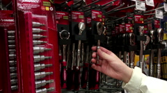 Woman buying Husky full polish ratchet at Home Depot store - stock footage