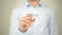 Coffee Shop, Man writing on transparent screen Stock Footage