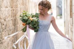 Young bride portrait with a wedding bouquet Stock Photos