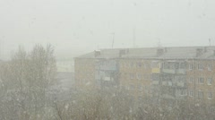 Block of flats under the snowstorm - stock footage