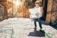 Young tourist with city map stay on the old italian street Stock Photos