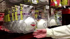 Woman buying particulate respirator at Home Depot store Stock Footage