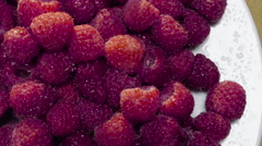 Overhead, closeup shot of fresh organic raspberries Stock Footage