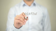 Creative Power, Man writing on transparent screen Stock Footage