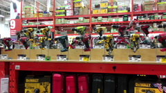 Pan shot of display electric drills at Home Depot store Stock Footage