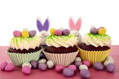 Happy Easter cupcakes with bunny easter eggs. - stock photo