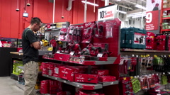 Man looking new electric drills at Home Depot store Stock Footage