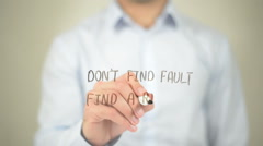 Don't Find Fault, Find a Remedy, Man writing on transparent screen Stock Footage