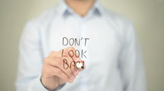 Don't Look Back, Man writing on transparent screen Stock Footage