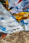 Leh gompa and lungta prayer flags. Leh, Ladakh, India Stock Photos
