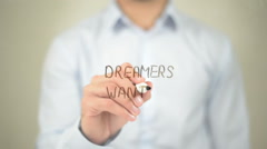 Dreamers Wanted, Man writing on transparent screen Stock Footage