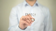 Energy Management, Man writing on transparent screen Stock Footage