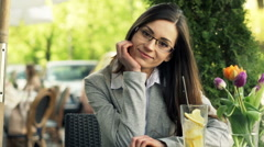 Portrait of happy, elegant woman sitting in cafe in city Stock Footage