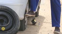 Releasing screws of flat tire Stock Footage