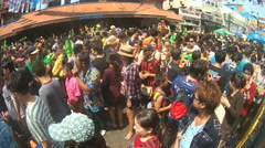 People take part in water battles on street during Songkran featival. Stock Footage