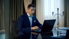 handsome man working on laptop - stock footage