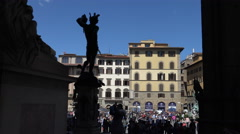 Tourists admire Perseus with head of Medusa bronze scupture  in Loggia, Florence Stock Footage