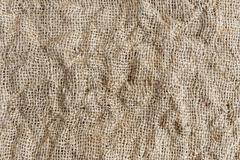 Burlap or sackcloth background with shadows  cotton. Kuvituskuvat