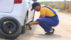 Roadside assistance service man in action Stock Footage
