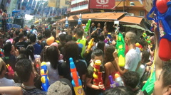 People take part in water battles on street during Songkran featival - stock footage