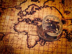 Old vintage compass on ancient map - stock photo