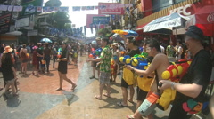 People take part in water battles on street during Songkran featival Stock Footage