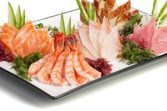 Set of Sashimi on Daikon with Seaweed, Cucumber - stock photo