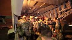 Soldiers of the Ecuardian Armed Forces sitting in the cargo area of a FAE-1032 a - stock footage