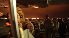 Soldiers in Ecuador boarding large FAE-1032 military transport plane at night to Stock Footage