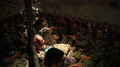 Ecuadorian Armed Forces in the cargo area praying Stock Footage