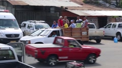 Group of men riding in the back of a truck in the street in Muisine, Ecuador Stock Footage
