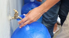 A large line of people filling up gallons of water in Ecuador after quake (2) - stock footage
