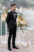 Sexy man in tuxedo posing - stock photo