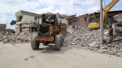 Bull dozer picking up rubble after the major quake in Ecuador Stock Footage