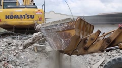 Bull dozer pulling out twisted rebar from a collapsed building, 2016 Ecuador - stock footage