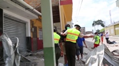 Police warning people to stay away from rubble after the 2016 Ecuador quake - stock footage