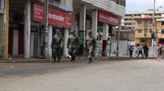 Soldiers in the Armed Forces of Ecuador walking down a street in Ecuador, 2016 Stock Footage