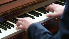 Playing piano. man playing piano - stock footage