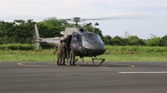 Ecuadorian Armed Forces standing beside a helicopter taking off - stock footage