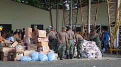 EAF soldiers preparing packages to give to people, Ecuador quake 2016 Stock Footage