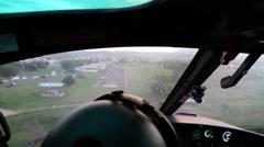 Helicopter coming into a landing strip in Ecuador Stock Footage