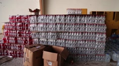 Stacked cases of drinks stored for people effected by the 2016 Ecuador quake Stock Footage