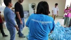 Volunteers in Ecuador packing bags of supplies, 2016 Ecuador quake Stock Footage