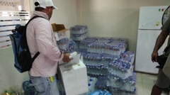 Large stacks of cases of water, 2016 Ecuador quake (1) Stock Footage