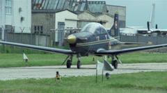 Small plane moves along hangar Stock Footage