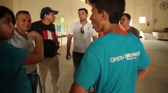 A group of volunteers in Ecuador talking to each other Stock Footage