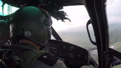Copilot of a helicopter checking his instruments over the forests of Ecuador (1) Stock Footage